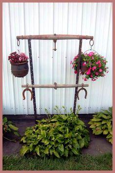 Nancy K Meyer's singletree plant hanger is displayed as well as displaying her flowerpots