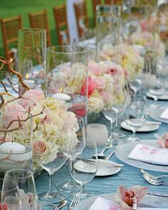 Long Centerpiece  Orchids, hydrangeas, and roses sit in driftwood boxes -- perfect for decorating an elongated table.