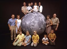 This incredible 1969 family portrait of NASA's Apollo 11 astronauts with their wives, children, and the friend who made them famous — the moon!