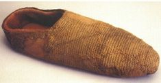 Photo of York sock. The sock appears to be badly worn and may have been patched. It had a narrow red band (dyed with madder) around the ankle. It is unclear whether this was a decorative edge or whether it once continued into a red stocking-type garment that has been lost.