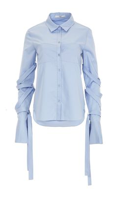 This menswear-inspired button-down shirt features removable straps that tie around the sleeves.  Cut from crisp cotton-poplin, this style has an oversized fit and a contrasting bodice panel. Give yours a contemporary feel by wearing it half tucked with tailored pants.    White styled with Denim Slouch Pants and Kari Sandals. Morning Blue styled with Frida Slides.   100% Cotton. Professional Dry Clean Only.   Style Number: TR216SPP74774   Available in: White, Morning Blue