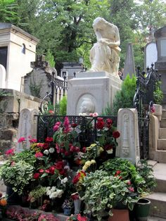 Gravestone of Frederic Chopin  -  Photos from Père Lachaise Cemetery  -  By Kimberly Powell The grave of Frederic Chopin is covered in flowers from. visitors to Pere Lachaise Cemetery in Paris, Franxe.