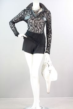 This sheer, paisley lace long sleeve blouse is stylish and ultra feminine. It features vegan leather accents on the collar, button placket and faux pocket flaps to add to the appeal. The fabric has a slight stretch for comfort. For a conservative look, layer it with a camisole or wear it with a black bra for an edgy look. The blouse is available in Midnight Black or White. Small, Medium and Large. 85% Polyester, 15% Spandex. $34.99