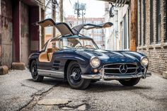 When the Mercedes-Benz 300 SL Gullwing was released in 1954, it was the fastest production car money could buy. The name was derived from the engine capacity of 3 litres (2996cc) and the German words Sport Leicht (Sport Light) – as a reference to its spaceframe chassis, and the aluminium doors, hood, and trunk. An...