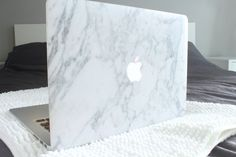 White Marble MacBook Air Sticker Case- I will buy this. Only 25 bucks