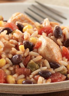 Fiesta Chicken with Rice and Beans... A slow cooker meal with a Tex-Mex twist. A full 15 minute meal packed with bold flavors such as tomatoes and green chilis. Great for leftovers the rest of the week!