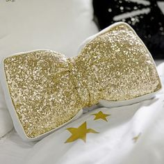 The Emily + Meritt Sequin Bow Pillow #pbteen | This bow pillow is so cute! Bows are one of my favorite decorative pieces. You could use this during the holidays since it is gold, or year round as well! Metallics and sequins are also huge trends right now :)
