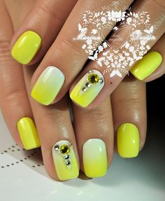 White and Yellow Ombred Nail Art with Studs. Just pattern your nails with the yellow and white ombre and stud it up with the stones you have in your jar and have the most amazing yellow colored nail art design.