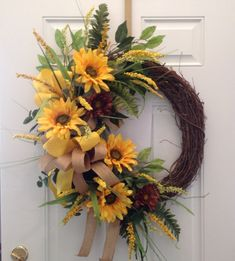 This large Sunflower wreath is home to 4 large yellow sunflowers and 2 brown daisies. It is adorned by both a butter yellow satin bow and a Sunflower Burlap Wreaths, Deco Mesh Wreaths, Holiday Wreaths, Door Wreaths, Floral Wreaths, Wreath Crafts, Diy Wreath, Grapevine Wreath, Wreath Ideas
