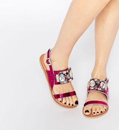 Metallic pink sandals adorned with shiny jewels.