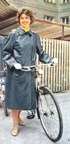 Cycling in her grey Klepper coat