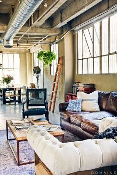 The city house. Open floor plan loft apartment with leather couch, ladder, wooden coffee table. Loft Design, Design Case, House Design, Design Design, Design Trends, Loft Apartment Decorating, Apartment Living, Loft Spaces, Living Spaces