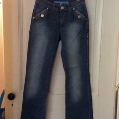 """Escada jeans, small, 36 Escalating Sport jeans, great color, size 36 European, small US. Waist 14"""" x 2, hips 17 1/2"""" x2, length 40"""" from waist, waist to crotch, 9"""". Gold Escada buttons 3 in front, 2 on rear pockets. Red leather back belt loops,  and pocket loops Red stitching. In very good shape. Escada Jeans"""