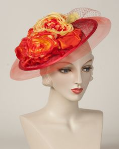 Whimsy, scarlet with flame, sinamay base with silk roses & horsehair edge