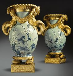 A pair of gilt-bronze-mounted Chinese celadon vases aux tritons, the mounts attributed to Pierre Gouthière (1732-1813)the mounts Louis XVI, circa 1770, the porcelain Qianlong (1736-1795)