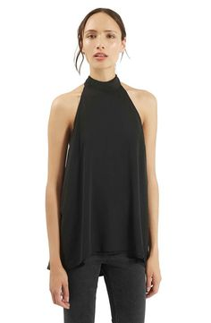 Cutaway shoulders frame the swishy halter neckline of a drapey, dual-layer top finished with a flattering high/low hem.@nordstrom
