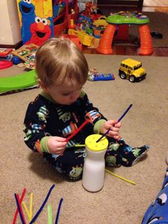 Puff container and pipe cleaners. Toddler activity.