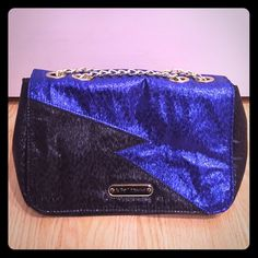 Betsey Johnson black & blue lightning handbag Betsy Johnson black & blue metallic lightning bolt handbag with gold chain straps.  NWOT. Betsey Johnson Bags