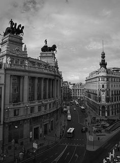 Two historic buildings. On the left, the Circle of Fine Arts and on the right the orginal headquarters of Banco Español de Crédito, Madrid, Spain