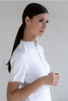 Bella - Detailed with a delicate sheer ruffle and tailored fit makes this uniform beautifully feminine.
