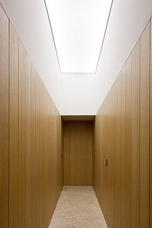 Top lit corridor inside the PA House in Barcelona by Spanish architect Francesc Rife Studio.