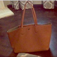 """Tory Burch Perry Tote Used once. Pristine condition. Gold metallic inside. Holds a full day's essentials, plus a 15"""" laptop and an extra pair of shoes. Flat leather handles with 9.4"""" (24 cm) drop. 1 interior hanging pocket with 2 open pockets. Tory Burch Bags Totes"""