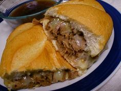 French Dip Sandwiches with Au Jus-2 cans beef broth (4cups) 2 packages lipton onion soup mix. cook in crockpot  on low for 7-8 hours then shred with fork, but on french bread with provolone cheese! you use the extra juice in the crock pot as au jus!