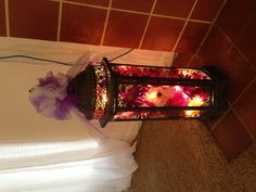 Lantern decorated with lights and silk flowers
