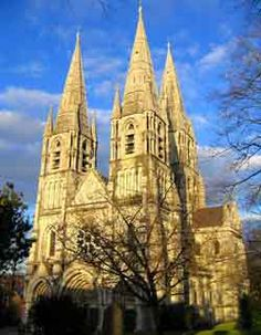 St Fin Barre's Cathedral, early French gothic style with three spires and several statues. More at Ireland Calling.