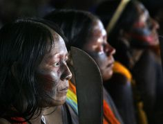 Indigenous women, bearing machetes, protest against the construction of the Belo Monte hydropower dam in Altamira, Brazil, Tuesday, May 20, 2008