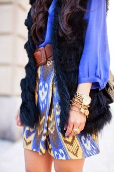 long fur vest. this would look awesome with a lacy long sleeved shirt underneath