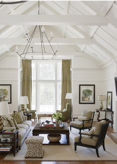 neutral living room with exposed beams