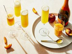 Bellini | Originated in Venice, Italy, this Champagne cocktail has become one of the most popular brunch drinks of all time. Its best made with fresh peach puree.  #drinks #cocktails #recipe #marthastewart