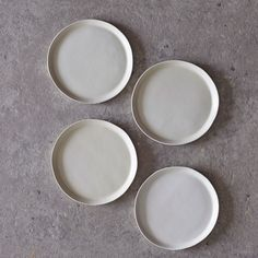 Image of set of four salad plates in white satin matte