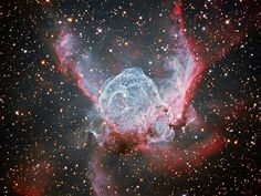 Thor's Helmet is a nebula found in the constellation Canis Major. As seen in this recently released picture from the Cerro Tololo Inter-American Observatory in Chile, the cosmic cloud of dust and gas is being shaped like a winged helm by outpourings of radiation from the massive stars inside.