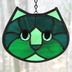 Green stained glass kitty by livingglassart home of oddballs and oddities, via Flickr