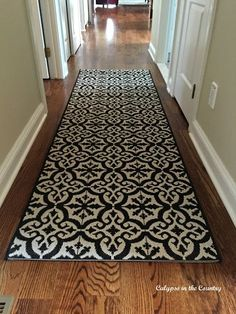 new hall runner an rug with a tile look
