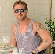ryan gosling is delish. i love that he has a giving tree tattoo!