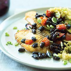 Tilapia with Quinoa & Black Beans Recipe - I made this with rice and orange peppers because that's what I had.  I also added chili powder.  YUM!