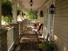 This is one of my favorite porches.  Love the lanterns on the porch also.