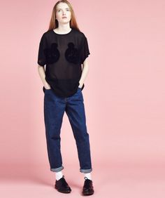 Bear all in our latest chiffon tee! This loose fit layering staple is crafted from breathable black mesh, with textured flock faces covering your nippy bits