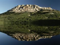 Beartooth Lake  Photograph by Raymond Gehman  Wyoming's Beartooth Lake doubles the grandeur of a grassy butte.