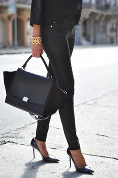 black jeans, pumps, bag, and gold Tory Burch