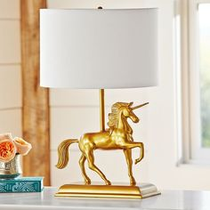 Gold Unicorn Table Lamp from PBteen - love this look in a nursery, kids room or teen's room! So fun and whimsical.