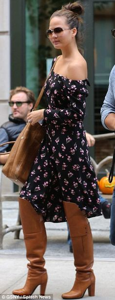 Chrissy Teigen.. of the shoulder dress.. thigh-high boots.. brown satchel..