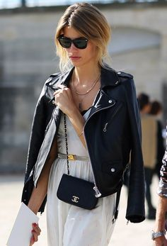 Leather jacket over a white dress.
