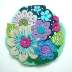 POCKETFUL OF POSIES FELT BROOCH by APPLIQUE-designedbyjane, via Flickr