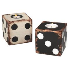 Two dice-shaped tealight holders in antiqued white and black. Product: 2 Piece tealight holder setConstruction Material...