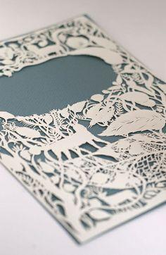 Intricate laser cut book cover design