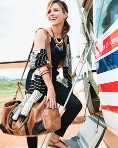 """#TBT to showing @sophiabush around Uganda this summer! We loved seeing her bring our beautiful products to life! """"Visiting a company making such gorgeous fashion that's also empowering women in their communities was such an amazing experience."""" We  you Sophia! {Here Sophia is rocking our Weekender Duffle and Wanderlust Shawl link in profile!} #ssekostyle #sophiabush"""